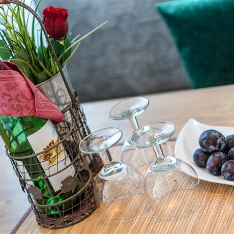Table with decoration and wine glasses